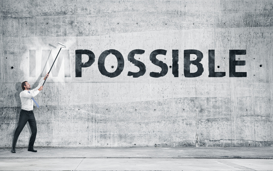 "possible - Man turning the word ""Impossible"" into ""Possible"""